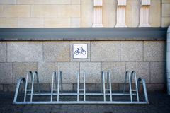 Bike rack by the wall Royalty Free Stock Images