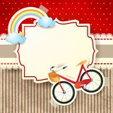 Bike and rainbow on cardboard background Stock Photo