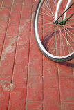 Bike on red brick road Stock Image