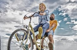 Bike rental or bike hire for short periods of time. Couple with bicycle romantic date sky background. Couple in love royalty free stock images