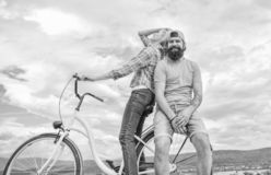 Bike rental or bike hire for short periods of time. Date ideas. Couple with bicycle romantic date sky background. Man. And women rent bike to discover city royalty free stock photography