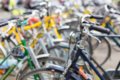 Bike rental service - Many bikes standing in bike stands. Available for rent as a great mean of transport in the city Royalty Free Stock Photos