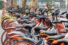 Bike rental service. Many olors bikes in a city context.  Stock Image