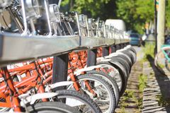 Bike rental service for a sustainable transport in the city. Empty copy space royalty free stock photography