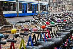 A bike rental station on a rainy day in Amsterdam. A lot of colored bicycles at the bike rental station on a rainy day in Amsterdam Stock Images