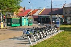 Bike rental station in Stalowa Wola, Poland. Stalowa Wola, Poland - April 29, 2018: Bike rental station at the center of Stalowa Wola. Cycling is a popular stock photo