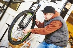 Bike repair or adjustment Stock Images