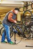 Bike repair or adjustment Royalty Free Stock Photos