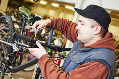 Bike repair or adjustment Stock Photo