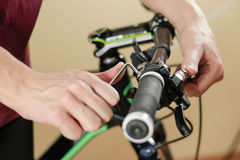Bike repair. Bicycle fixing. Hex wrench works. Man configures th. E bike stock photo