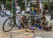 Bike repair business on a corner of the street. Royalty Free Stock Photo