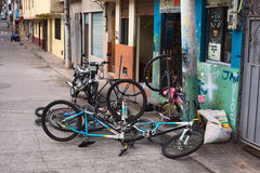 Bike Repair Shop in Banos, Ecuador. BANOS, ECUADOR - AUGUST 1, 2014: Bicycles in front of a bike repair shop on Juan Leon Mera street on August 1, 2014 in Banos Stock Photo