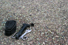Bike repair tools on asphalt. Road royalty free stock image