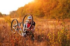 Bike repair. Young man repairing mountain bike Royalty Free Stock Photos