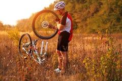 Bike repair. Young man repairing mountain bike Royalty Free Stock Image