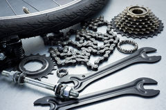 Bike repairing. Spare parts and tools Royalty Free Stock Photos