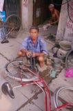 Bike repairman Stock Images