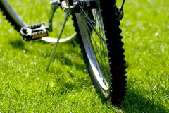 Bike rest. Mountain Bike resting on the grass Royalty Free Stock Images