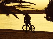 Bike ride. Man with a bike by the river Stock Photography