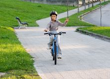 Bike ride. A boy is riding bike without hands Royalty Free Stock Photo