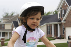 Bike ride. A young girl enjoying riding her bike Royalty Free Stock Photo