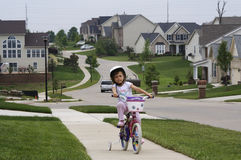 Bike ride. A young girl enjoying riding her bike Stock Photo