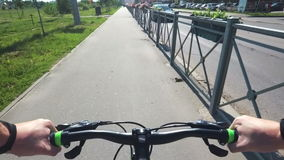 Bike ride from the first person in the park in the summer stock video
