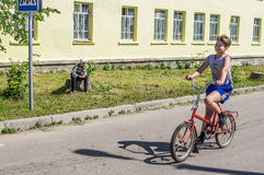 Bike ride in a Russian village in the Kaluga region. Royalty Free Stock Images