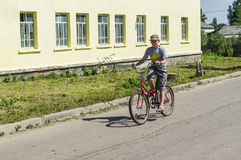 Bike ride in a Russian village in the Kaluga region. Royalty Free Stock Photo