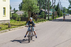 Bike ride in a Russian village in the Kaluga region. Royalty Free Stock Image