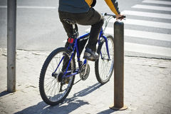 Bike rider. Undefined bike rider crossing street Royalty Free Stock Photos