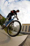 Bike rider. Freestyle young male rider, urban location. Fish-eye lens Stock Photo