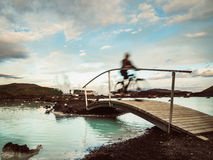 Bike-rider at Blue Lagoon - Iceland Stock Images