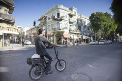 Bike rider Facade of old house Israel Stock Image