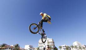 Bike rider tricking while jumping during bikes competition Royalty Free Stock Photos