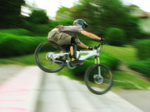Bike rider at urban downhill competition Royalty Free Stock Photos