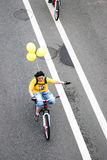 A bike rider in yellow t-shirt Royalty Free Stock Images