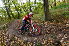 Bike riders at downhill competition. Royalty Free Stock Images