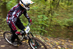 Bike riders at downhill competition. Royalty Free Stock Photography