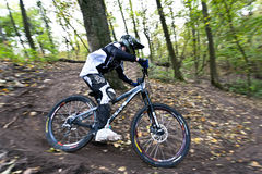 Bike riders at downhill competition. Stock Image
