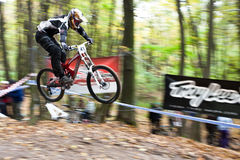 Bike riders at downhill competition. Royalty Free Stock Photos