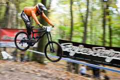 Bike riders at downhill competition. Stock Photo