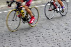 Bike riders on the street. Motion blur abstract of a bike riders on the street Stock Photo
