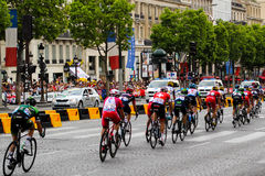 Bike riders. Tour de France, Fans in Paris, France. Sport competitions. Bicycle peloton. Royalty Free Stock Photos