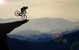 Bike rides in unusual places. Crazy biker;bike rides in unusual places royalty free stock photos