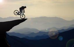 Bike rides in unusual places. Crazy biker;bike rides in unusual places royalty free stock photos