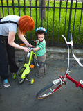 Bike riding. Mother and son preparing for a family bike riding royalty free stock photo