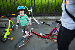 Bike riding. Mother and son preparing for a family bike riding royalty free stock images
