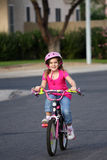Bike Riding. A little girl riding her bike in the neighborhood Royalty Free Stock Image