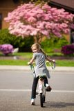 Bike Riding Child. A cute kid looking back while riding a bicycle Royalty Free Stock Image